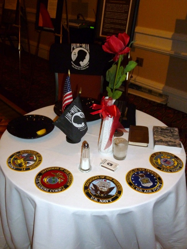 The POW-MIA table setting was part of a tribute during the dinner program. & The POW-MIA table setting was part of a tribute during the dinner ...