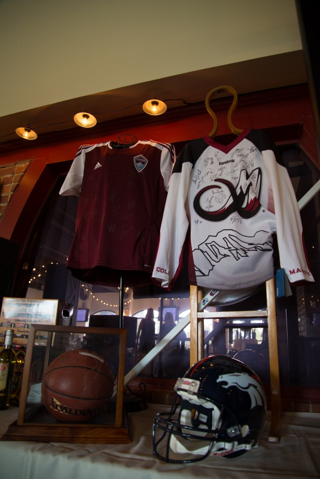 Sports memorabilia up for bid during the live auction for How to bid at a live auction