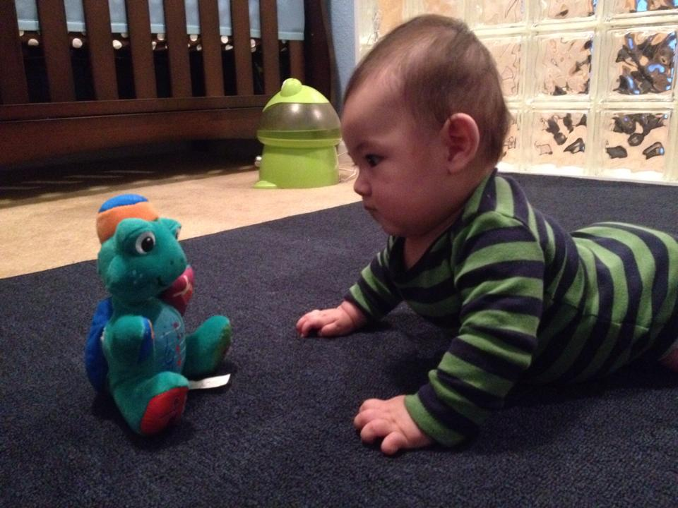 Rylan Gillette, son of HYM Christine Chang Gillette and Damon Gillett stares down his favorite toy