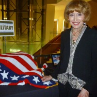Marlene Siegel checks out a crocheted patriotic throw at the silent auction.