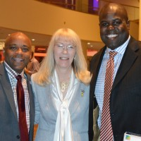 Denver Mayor Michael Hancock, Archway's executive director Joyce Alms Ransford and former Bronco and event emcee Reggie Rivers
