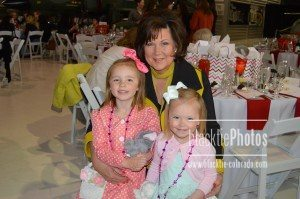 Carla McElroy and her granddaughters find their table for the luncheon.