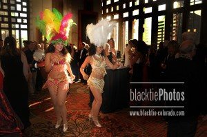 Carnavale dancers lead dinner guests to their seats