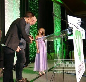 Joe King and Isaac Slade of The Fray present the Volunteer of the Decade award to 11-year-old Vienna Danna