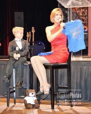 "Cheryl Preheim shows off son Josh's t-shirt design: ""Brave Conquers Fear."""