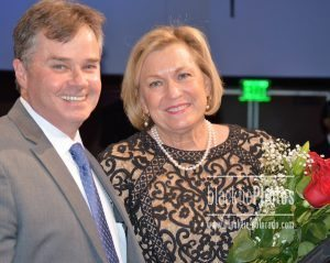 Stout Street's president Christopher Conway presented Susan Ford Bales with roses after her moving talk.